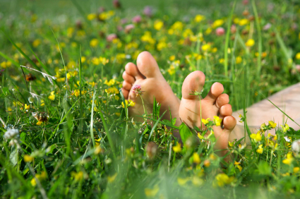 The beautiful feet lying on a lawn